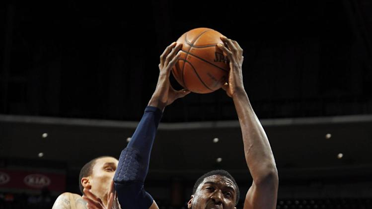 Indiana Pacers center Roy Hibbert, front right, pulls in a rebound in front of Pacers guard George Hill, front left, and Denver Nuggets guard Andre Iguodala, back, in the first quarter of an NBA basketball game in Denver on Monday, Jan. 28, 2013. (AP Photo/David Zalubowski)