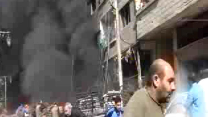 This image taken from video obtained from Ugarit News, which has been authenticated based on its contents and other AP reporting, shows smoke and fire after a fighter jet crashed into a suburb of Damascus, Syria, Wednesday, Feb. 20, 2013. The United Nations says at least 70,000 people have been killed since the conflict began in March 2011 as an uprising against Bashar Assad's rule. The revolt turned into a civil war that has taken increasingly sectarian overtones with mostly Sunni Muslim opposition forces fighting to topple the regime dominated by Alawites, an offshoot Shiite group.(AP Photo/Bambuser, SNN Hamouria via AP video)
