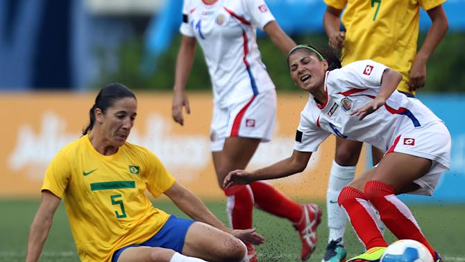 Brazil's Daiane Rodriguez, left, fights for the ball with Costa Rica's Yendry Villalobos during a women's soccer match at the Pan American Games in Guadalajara, Mexico, Thursday, Oct. 20, 2011. (AP Photo/Juan Karita)