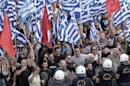 Supporters of the far right Golden Dawn party wave flags and shout slogans outside the Athens Appeals Court on July 4, 2014