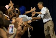 US President Barack Obama greets supporters as he arrives to speak during a campaign event at the Florida Institute of Technology in Melbourne, Florida, September 9, 2012, during the second day of a 2-day bus tour across Florida