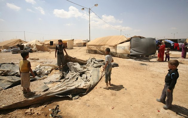 Syrian refugees inspect their tent, which was burned during rioting at Zaatari Syrian refugee camp in Mafraq, Jordan, Wednesday, Aug. 29, 2012. Jordan&#39;s has warned Syrian refugees in its tent camp near the Syrian border against rioting. Public security officials say rioting by 200 refugees late Tuesday over the camp&#39;s &#39;poor services&#39; injured 26 Jordanian security officers. (AP Photo/Mohammad Hannon)