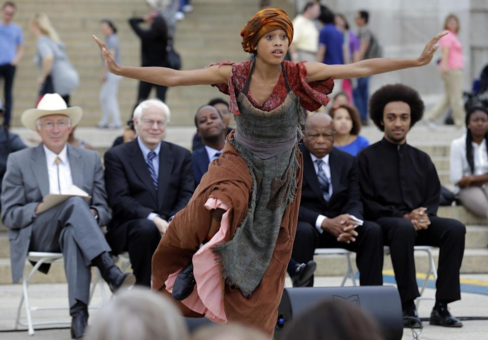 Christen Williams does an interpretative dance at an event sponsored by the National Endowment for the Humanities and Howard University to commemorate the 150th anniversary of Abraham Lincoln's Emancipation Proclamation, on the steps of the Lincoln Memorial Monday, Sept. 17, 2012, in Washington. (AP Photo/Alex Brandon)