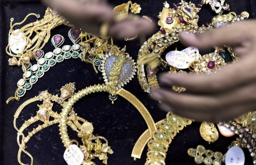 <p>A jeweller arranges gold necklaces for a prospective trader at his workshop in Mumbai in 2009. The International Monetary Fund approved Friday $2.7 billion in gold sales profits to boost financing to low-income countries.</p>