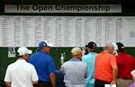 PLANO, TX - MAY 20:  Fans and players watch the leader board during The Open Championship International Final Qualifying America at Gleneagles Golf and Country Club on May 20, 2013 in Plano, Texas.  (Photo by Tom Pennington/R&A via Getty Images)