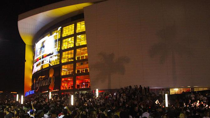 Fans crowd outside AmericanAirlines Arena after the Miami Heat won Game 5 of the NBA finals basketball series against the Oklahoma City Thunder, Thursday, June 21, 2012, in Miami. The Heat won 121-106 to become the 2012 NBA Champions. (AP Photo/CX Matiash)