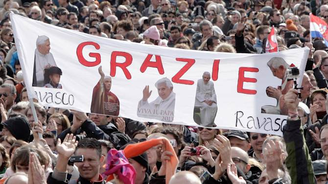 """Faithful hold up a banner with pictures of Pope Benedict XVI and writing reading in Italian """"Thank you"""" as they attend Benedict's last Angelus prayer, in St. Peter's Square, at the Vatican, Sunday, Feb. 24, 2013. Benedict XVI gave his pontificate's final Sunday blessing from his studio window to the cheers of tens of thousands of people packing St. Peter's Square, but sought to reassure the faithful that he wasn't abandoning the church by retiring to spend his final years in prayer. The 85-year-old Benedict is stepping down on Thursday evening, the first pope to do so in 600 years, after saying he no longer has the mental or physical strength to vigorously lead the world's 1.2 billion Catholics. (AP Photo/Riccardo De Luca)"""