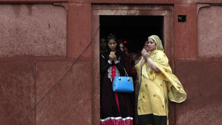 Pakistani Muslims say their Eid al Fitr prayers at the Badshahi mosque in Lahore