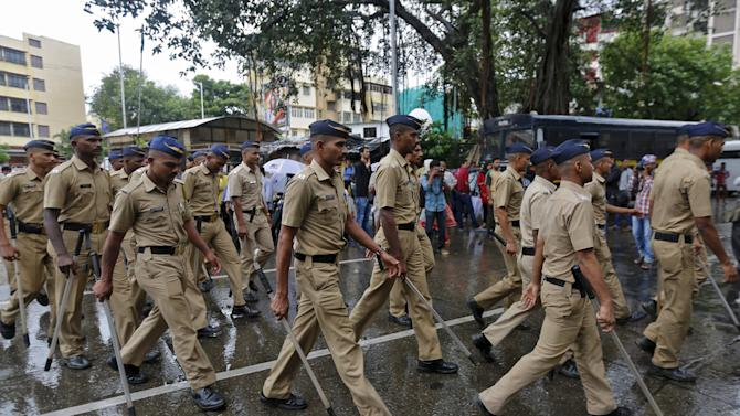 Indian policemen patrol a road near to the residence of Memon in Mumbai