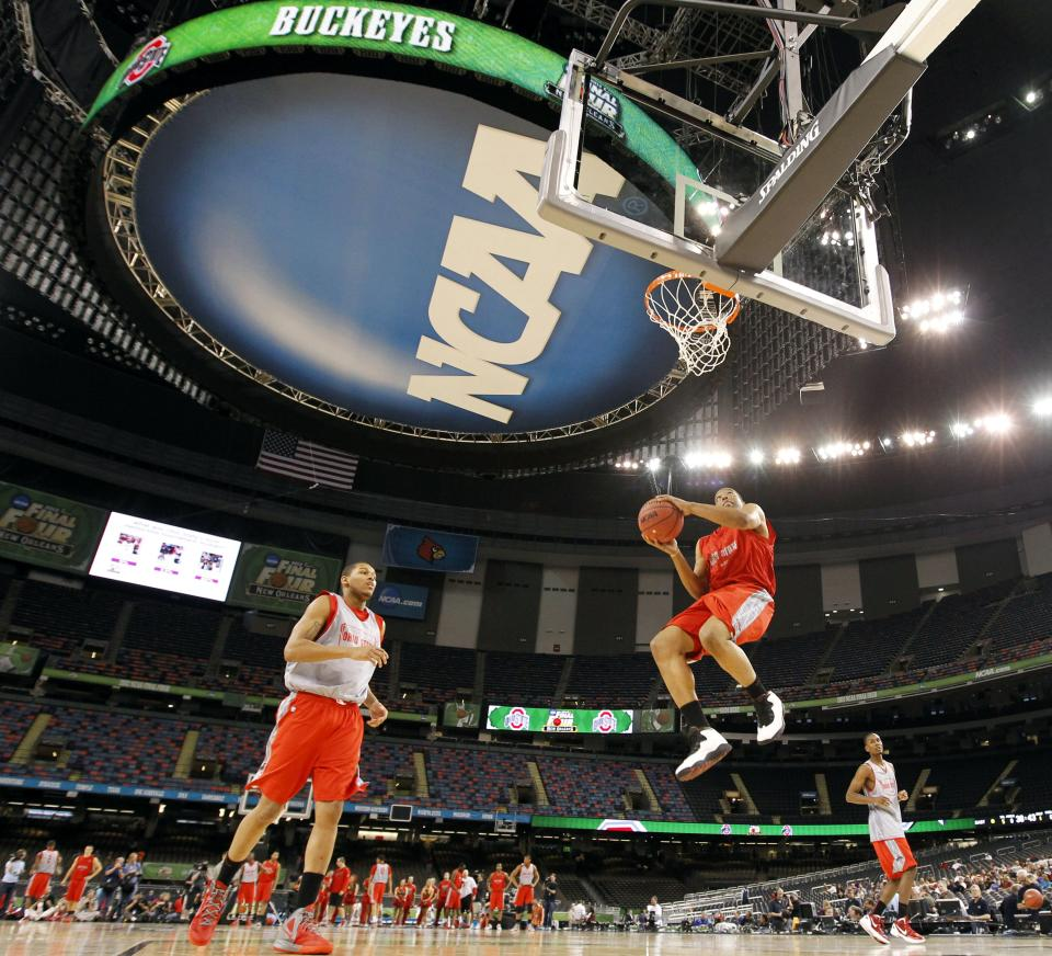 Ohio State players run a drill during a practice session for the NCAA Final Four basketball tournament Friday, March 30, 2012, in New Orleans. Ohio State plays Kansas in a semifinal game on Saturday. (AP Photo/Gerald Herbert)