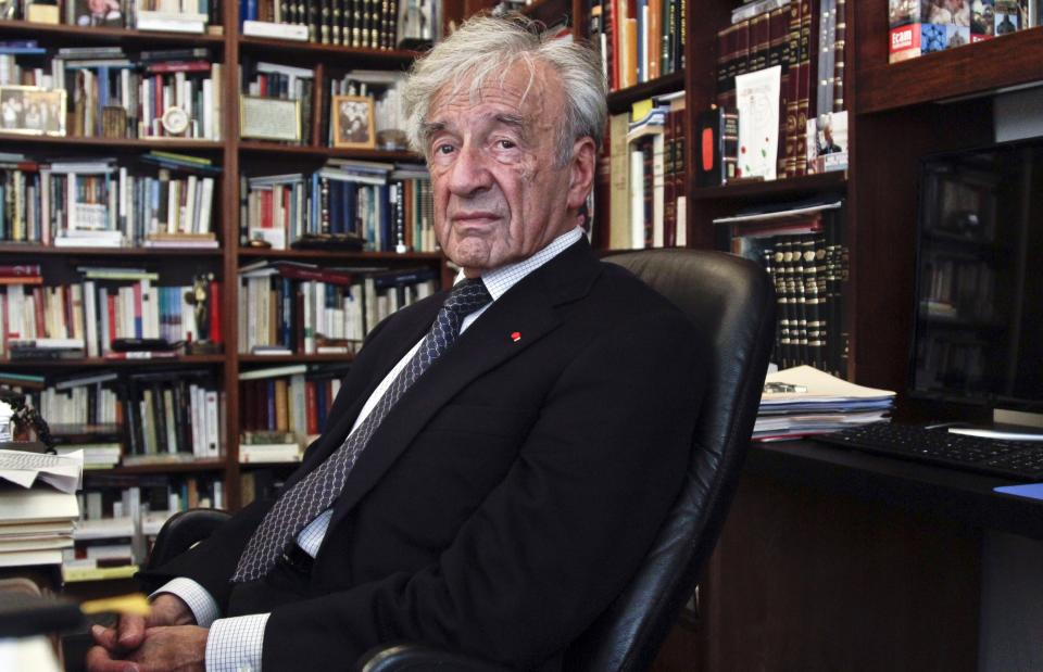 "This Sept. 12, 2012, photo shows Holocaust activist and Nobel Peace Prize recipient Elie Wiesel, 83, in his office in New York.  Weisel's latest book is titled, ""Open Heart.""  (AP Photo/Bebeto Matthews)"