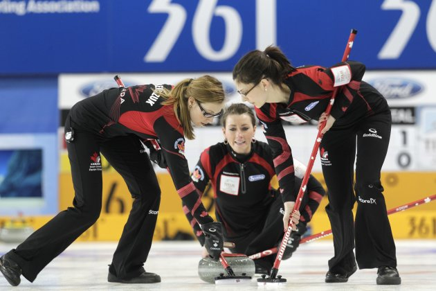 Canada's third Miskew watches a stone during their World Women's Curling Championship qualification round match against Switzerland in Riga