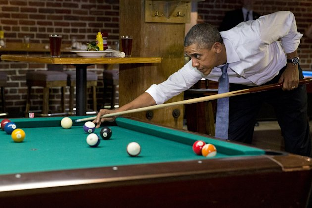 Obama plays pool with Colorado Gov. John Hickenlooper, not seen, July 8, 2014, in Denver. (Jacquelyn Martin/AP)