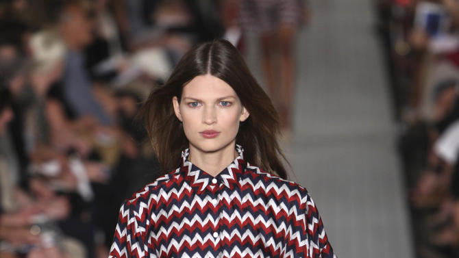 The Tommy Hilfiger Spring 2013 collection is modeled during Fashion Week in New York, Sunday, Sept. 9, 2012.  (AP Photo/Seth Wenig)