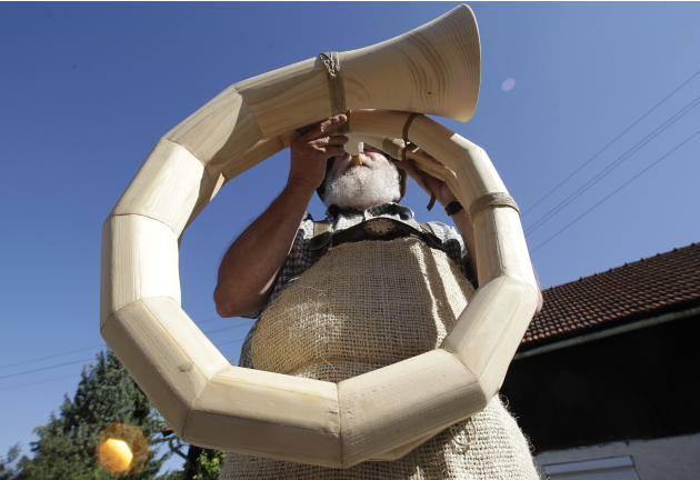 Alphorn maker Gstettner  tests an alphorn prototype in front of his garage in Vorchdorf