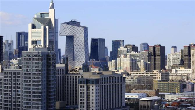 File photo of commercial and residential buildings standing in Beijing