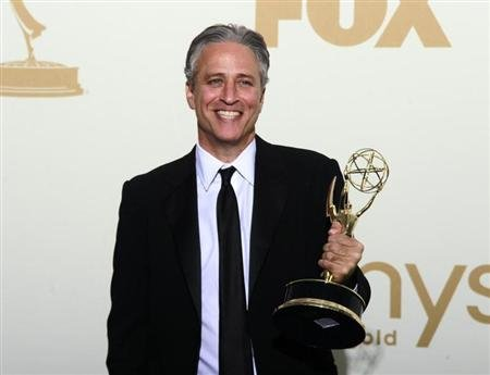 Television host Jon Stewart holds the Emmy award for the &quot;The Daily Show With Jon Stewart&quot; after winning for outstanding variety, music or comedy series, backstage at the 63rd Primetime Emmy Awards in Los Angeles September 18, 2011. REUTERS/Lucy Nicholson