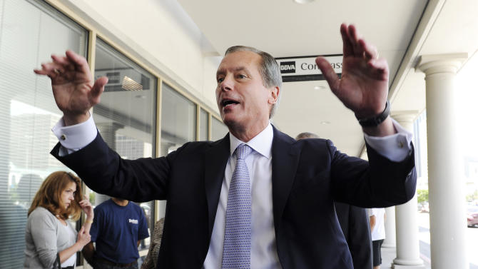 Texas Lt. Gov. David Dewhurst greets supporters outside a Houston deli Tuesday, July 31, 2012. Dewhurst faces former Texas Solicitor General Ted Cruz in the Republican primary runoff election for U.S. Senator. (AP Photo/Pat Sullivan)