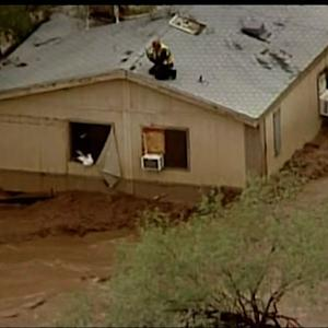 Watch: Phoenix resident rescued from house trapped by deadly storm
