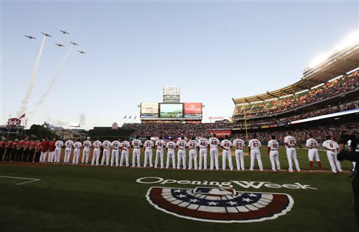 Members of the Los Angeles Angels line up before their home opener against the Oakland Athletics in Anaheim, Calif. Tuesday, April 9, 2013