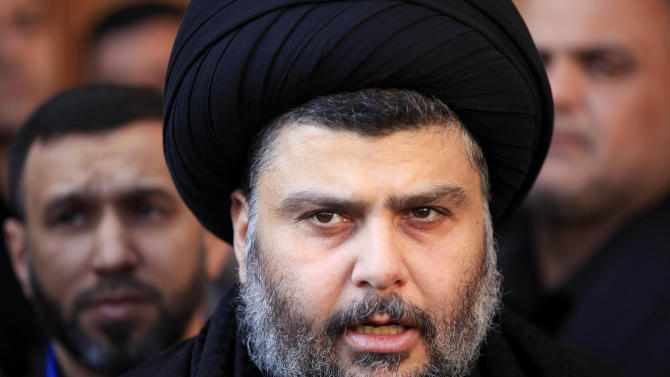 Firebrand Shiite cleric Muqtada al-Sadr speaks to the press at Our Lady of Salvation church in Baghdad, Iraq, Friday, Jan. 4, 2013. Al-Sadr paid a visit Friday to a Baghdad church that was the scene of a deadly 2010 attack as well as one of the Iraqi capital's main Sunni mosques, an apparent overture to other religious groups as opposition mounts against his rival, Prime Minister Nouri al-Maliki. (AP Photo/ Karim Kadim)