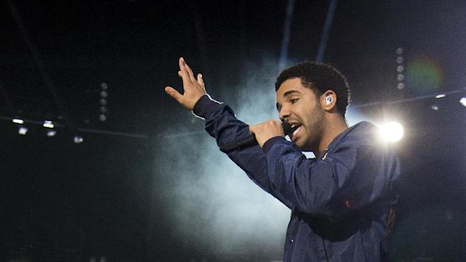"""FILE - In this Sept. 2, 2012 file photo, Drake performs at the """"Made In America"""" music festival in Philadelphia, PA. The rapper-singer is up for 12 honors at the 2013 BET Awards, including five nominations for video of the year, which has 10 nominees. The awards air live Sunday, June 30, 2013, from the Nokia Theatre L.A. Live, in Los Angeles. (Photo by Charles Sykes/Invision/AP, File)"""