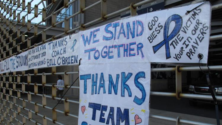 A hand-written sign hanging on the gate in front of the entrance for Penn State students at Beaver Stadium in State College, Pa., as seen on Monday, July 30, 2012. Penn State players have until the start of training camp on Aug. 6 to decide whether they will transfer following the NCAA sanctions against the program in the wake of the Jerry Sandusky child sex abuse scandal.  (AP Photo/Genaro C. Armas)