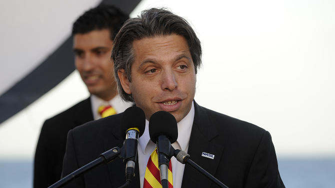 """In this Feb. 17, 2011, photo, Aaron Davidson, then-Fort Lauderale Strikers President and CEO,  speaks during a press conference in Fort Lauderdale, Fla. Swiss prosecutors opened criminal proceedings into FIFA's awarding of the 2018 and 2022 World Cups, only hours after seven soccer officials were arrested Wednesday, May 27, 2015, pending extradition to the U.S. in a separate probe of """"rampant, systemic, and deep-rooted"""" corruption. Aaron Davidson is one of 14 people indicted in the U.S. for corruption. The Swiss prosecutors' office said the U.S. probe was separate from its investigation but that authorities were working together.  (Michael Laughlin, The South Florida-Sun Sentinel via AP)"""
