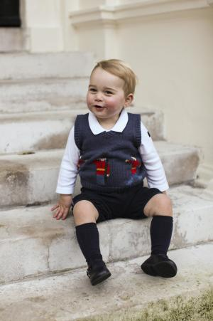 Britain's Prince George poses in a courtyard at…