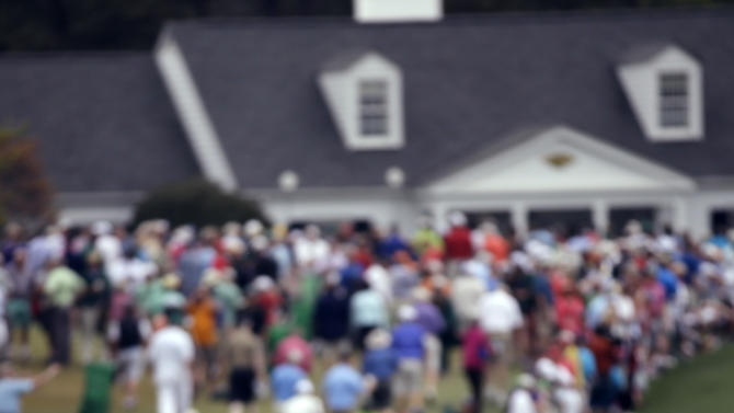 Amateur Guan Tianlang, of China, watches his second shot on the first fairway during the second round of the Masters golf tournament Friday, April 12, 2013, in Augusta, Ga. (AP Photo/David J. Phillip)