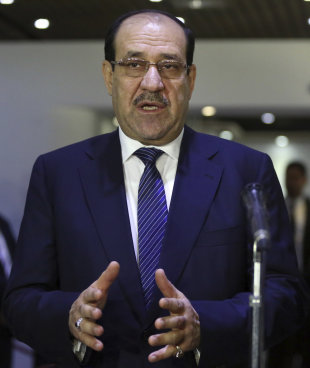 Iraqi Prime Minister Nouri al-Maliki, left, speaks during a press conference with the Sunni Speaker of Parliament Salim al-Jubouri, in Baghdad, Iraq, ...