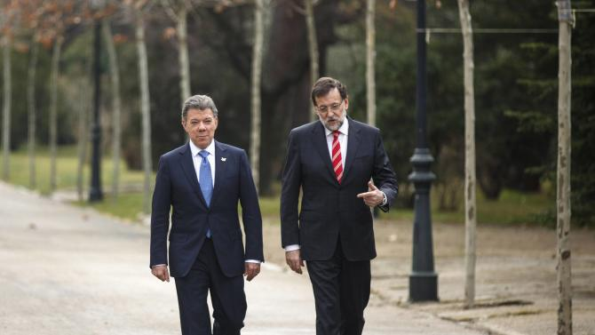 Colombia's President Santos and Spain's PM Rajoy talk during a walk at Moncloa Palace in Madrid
