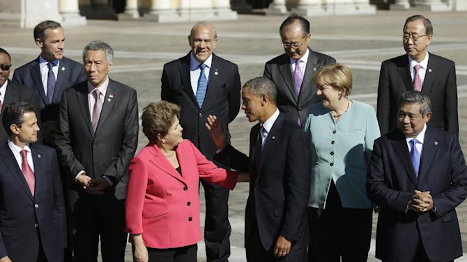 FILE - In this Sept. 6, 2013, file photo President Barack Obama, center, talks with Brazil's President Dilma Rousseff as he join with other leaders for the group photo at the G-20 summit at the Konstantin Palace in St. Petersburg, Russia. President Barack Obama's national security adviser conceded there are legitimate questions about U.S. spying on its allies, the White House said Wednesday, Sept. 11, 2013, as it sought to sooth Brazil's concerns about far-reaching surveillance by the National Security Agency. (AP Photo/Pablo Martinez Monsivais, File)