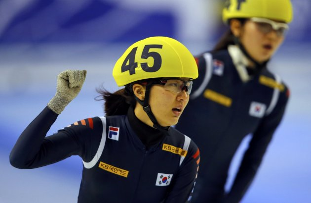 Park of South Korea celebrates her victory in front of second placed compatriot Shim during the women's 1500m finals at the ISU World Short Track Speed Skating Championships in Debrecen