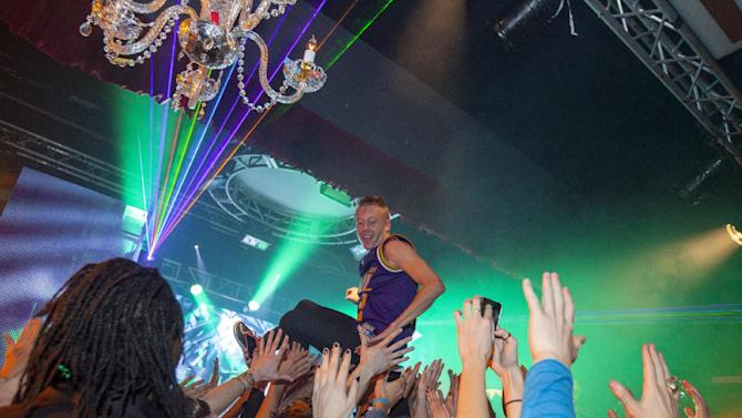 Macklemore of Macklemore and Ryan Lewis body surfs the crowd at Park City Live Day 9 on Friday, January 25, 2013, in Park City, Utah. (Photo by Barry Brecheisen/Invision for Park City Live/AP Images)