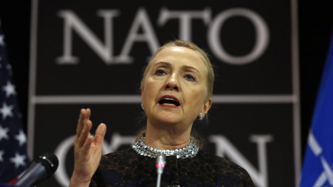 U.S. Secretary of  State Hillary Rodham Clinton speaks at a press conference at NATO headquarters in Brussels, Belgium, Wednesday Dec. 5, 2012. NATO foreign ministers were set Wednesday to shift their focus to the way forward in Afghanistan during a second day of talks in Brussels, as the military alliance prepares to withdraw its combat troops in 2014. (AP Photo/Kevin Lamarque, Pool)