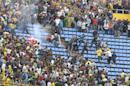 In this photo dated May 1, 2011, supporters of JS Kabylie and USM El-Harrah clash in the stands during of a soccer match in Algiers, Algeria. Angry fans in Algeria pelted their own soccer team with rocks after they lost a game, killing the star player, Albert Ebosse, in the latest incident of fan violence in this North African country. Ebosse died after being hit in the head by an object thrown from the crowd at a top-flight league game in Algeria on August 23, 2014. Like much of the rest of the continent, Algeria's restless youth are passionate about soccer but with little other outlet for their daily frustration, violence haunts the games. (AP Photo/Anis Belghoul)