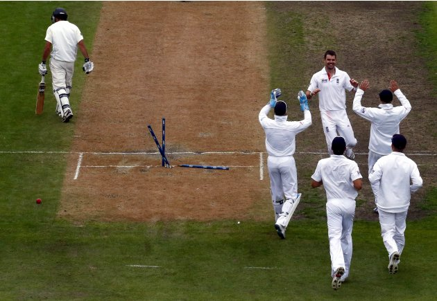 England's Anderson celebrates with team mates after dismissing New Zealand's Brownlie for 27 runs during the third day of the first test at the University Oval in Dunedin