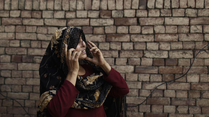 "In this Thursday, May 10, 2012 photo, Pakistani Allah Rakhi, 51, whose nose was sliced by her husband, adjusts her scarf at her home in  Thatha Pira, near Gujranwala, Pakistan. Allah Rakhi's husband sliced of her nose and right foot with a razor in 1980, when she was 19. The nose has special significance in Pakistani culture, where it symbolizes the honor of the family. A popular plea from parents to children is ""Please take care of our nose"", which means ""don't do anything that tarnishes the name of the family."" (AP Photo/Muhammed Muheisen)"
