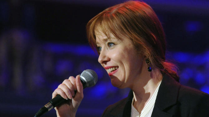 "FILE - This Dec. 23, 2011 file photo shows U.S. singer Suzanne Vega performing at the concert in honor of Vaclav Havel in Lucerna Hall in Prague. Vega has seen her work sampled by rap artists many times. Now she's showing the inspiration runs both ways. The New Yorker samples 50 Cent's song, ""Candy Shop"" in a track featured on her upcoming album, due in February. (AP Photo/CTK, Michal Dolezal) SLOVAKIA OUT"