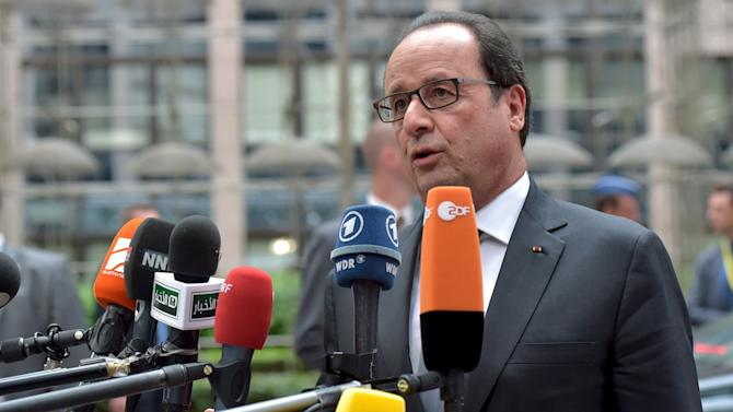 France's President Hollande arrives at a euro zone EU leaders emergency summit in Brussels