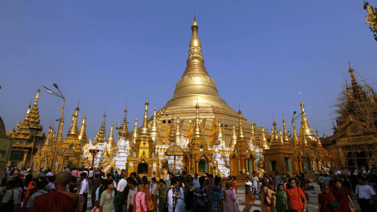 FILE - In this Tuesday, March 26, 2013 file photo, Buddhist devotees visit Yangon's famous Shwedagon pagoda on Full Moon Day of Tabaung, the last month in the Myanmar calendar, in Yangon, Myanmar. The Associated Press has become the first international news agency to open a bureau in Myanmar since a reformist government took power two years ago and began relaxing restrictions on the media for the first time in decades. The Information Ministry informed the AP on Saturday, March 30, 2013, it had granted the news agency permission to open a full-fledged office in Yangon. Japanese broadcaster NHK was also granted permission. (AP Photo/Khin Maung Win, File)
