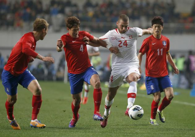 Switzerland's Pajtim Kasami fights for the ball against South Korea's players during their friendly soccer match at the Seoul World Cup stadium in Seoul