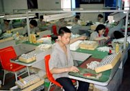 File picture of workers producing lighters at a factory in Wenzhou. The city accounts for a small portion of China's economy, so the impact of reforms is limited, but if rolled out across China the impact could be monumental