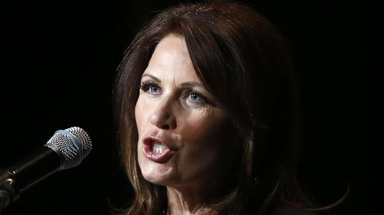 In this photo taken July 23, 2013, Rep. Michele Bachmann, R-Minn. speaks in Washington. The House Ethics Committee is launching a full-tilt investigation of Bachmann. The committee announced on Friday, July 26, 2013, it had received a referral from the Office of Congressional Ethics, an independent investigative body, and said in a brief statement that it would formally investigate the one-time Republican presidential candidate. (AP Photo/Charles Dharapak)