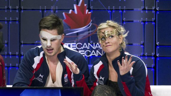 Hubbell and Donohue of the U.S. react after their scores were announced after performing during the ice dance short dance program during the 2014 Skate Canada International in Kelowna