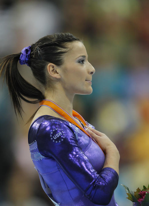 Gold medallist Alicia Sacramone of the U.S. listens to the national anthem on the podium after winning the women's vault finalof the World Championships Gymnastics in Rotterdam, Netherlands, Saturday