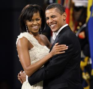 FILE - In this Jan. 20, 2009 file photo, President Barack Obama dances with first lady Michelle Obama at the Western Inaugural Ball in Washington.  President Obama is restricting the inaugural balls to the lowest number in 60 years with just two official parties plus a concert honoring military families planned for next month. (AP Photo/Charlie Neibergall)