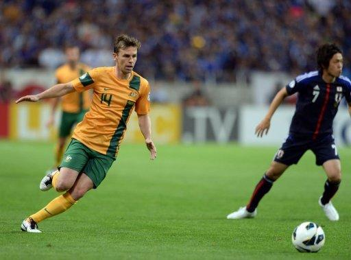 Australia's Brett Holman (L) pictured during a World Cup qualifying match in Saitama on June 4, 2013