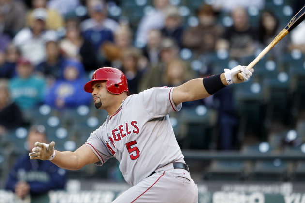 Los Angeles Angels' Albert Pujols grounds out against the Seattle Mariners in the first inning of a baseball game Wednesday, Oct. 3, 2012, in Seattle. (AP Photo/Elaine Thompson)